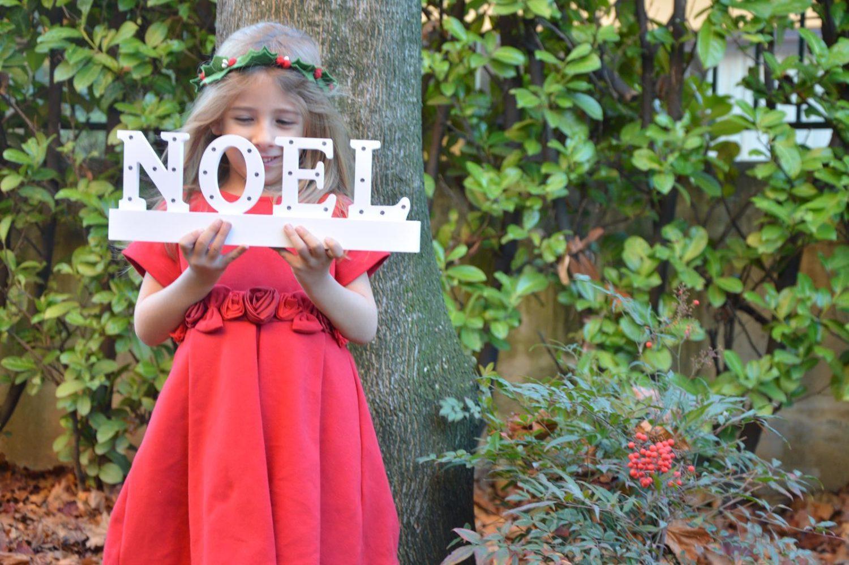 Rosso Natale: le foto natalizie con i bambini